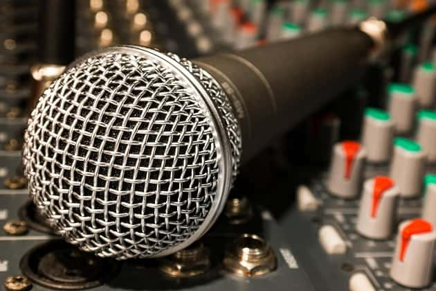 Microphone lying on sound equipment