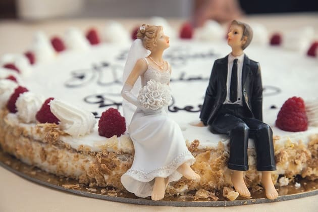 Bride and groom on top of a wedding cheese cake
